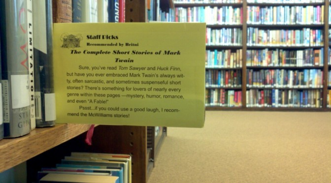 """photo of a """"staff pick"""" shelf card recommending the book """"The Complete Short Stories of Mark Twain"""""""