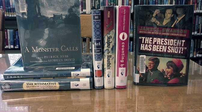 Photo of seven of the Rebecca Caudill Book Award Winners displayed on the library table