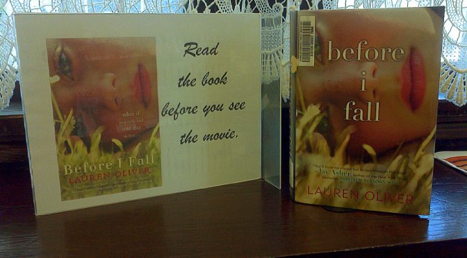 """photo of a book and sign that says """"read the book before you see the movie""""."""