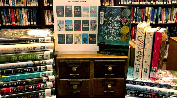 photo of all of the 2016 Abe Lincoln Award nominees displayed on the bookshelf island in the YA section