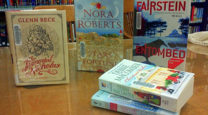 picture of some new adult fiction books
